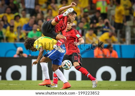FORTALEZA, BRAZIL - June 17, 2014: Brazilian player competes for the ball during the World Cup Group A game between Brazil and Mexico at Estadio Castelao. No Use in Brazil.