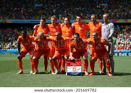 FORTALEZA, BRAZIL - JUNE 29, 2014: Team Netherlands pose for a photo during the World Cup Round of 16 game between the Netherlands and Mexico in the Castelao stadium. NO USE IN BRAZIL. - stock photo
