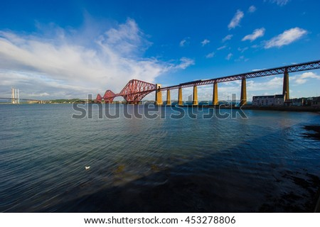 forth bridge on a sunny day. the forth rail bridge connects edinburgh to fife in scotland, uk