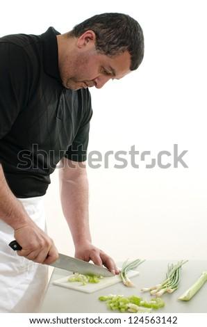 Forties hispanic american man cooking - stock photo