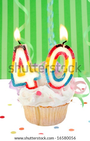 fortieth birthday cupcake with white frosting and green decorative background - stock photo