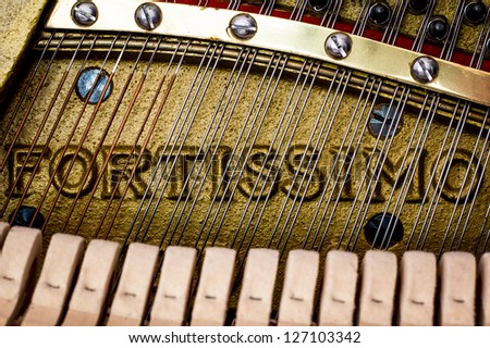Fortissimo - Closeup Of Piano Strings and Frame (not the brand of the instrument) - stock photo