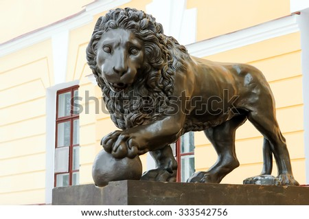Fortress Velikiy Novgorod, lion at the entrance to the Museum of the Novgorod fortress, ancient lion sculpture, travel and tourism, the historic city, UNESCO world heritage site. - stock photo