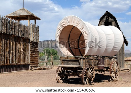 Fortress with lookout tower and wagon in the old West - stock photo