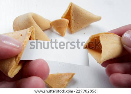 Fortune cookies in hands with advices, motivation mottos and blank space for copy - stock photo