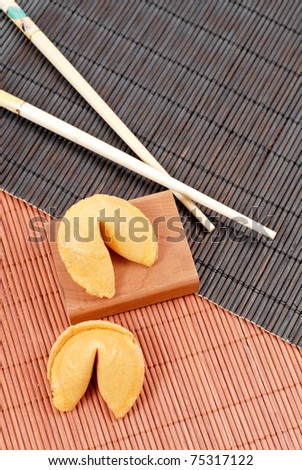 Fortune Cookies on Oriental Bamboo Mats - stock photo