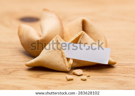 fortune cookies on wooden table - stock photo