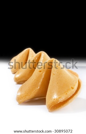 Fortune cookies over black and white background with copy space