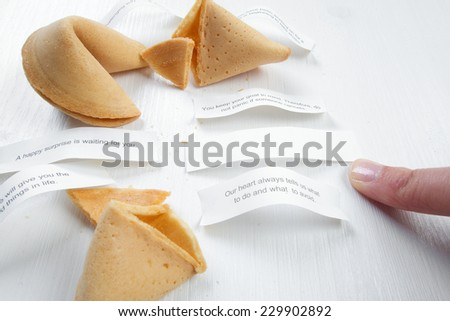 Fortune cookies with advices, motivation mottos and blank space for copy - stock photo