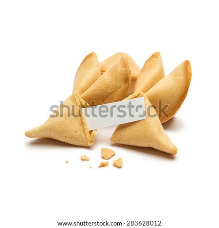 fortune cookies with crumbs and note on white background - stock photo
