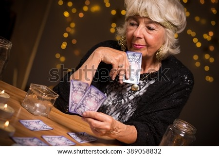 Fortune-teller forecasting the future from magic cards - stock photo
