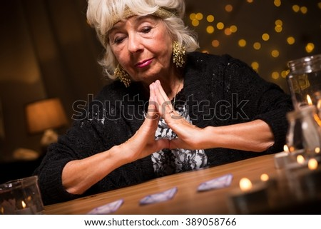 Fortune teller having a vision of future fate - stock photo