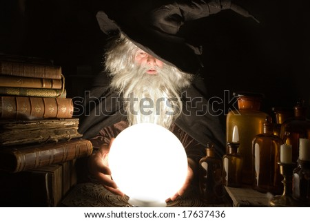 Fortune teller looking into the future at halloween - stock photo