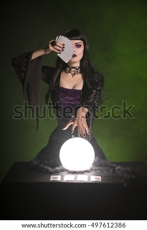 Fortune teller with playing cards and crystal ball, Halloween theme