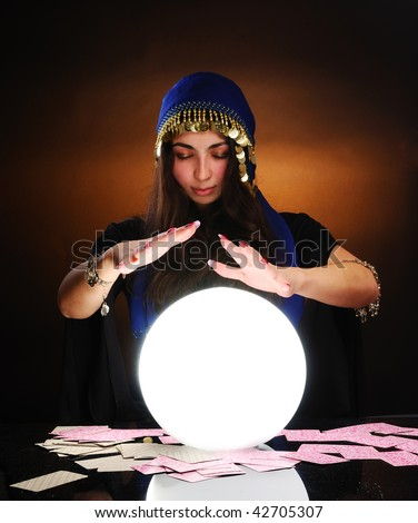 Fortuneteller at work - stock photo