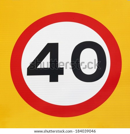 Forty miles per hour speed limit sign with a yellow background. - stock photo