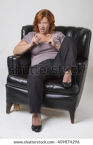 forty something woman with maniacal expression - stock photo