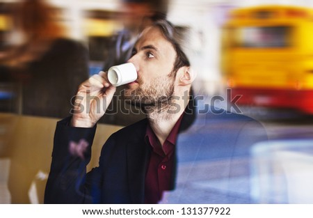 Forty years old businessman drinking espresso coffee in the city cafe during lunch time - stock photo