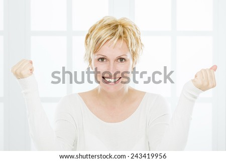 Forty years old, happy woman - stock photo
