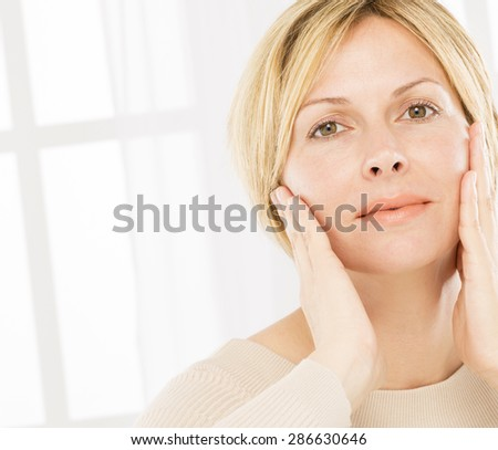 Forty years woman face and care - stock photo