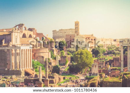 Forum - antique Roman ruins with Colosseum in Rome at sunny day, Italy, retro toned