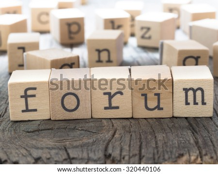 FORUM word made of wooden letters