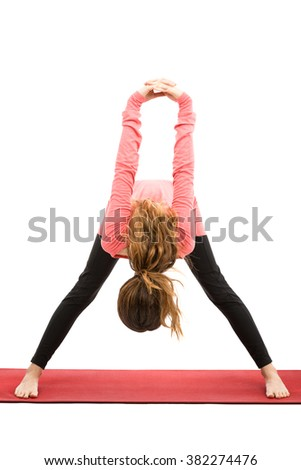 Forward bend with shoulder stretching in yoga - stock photo