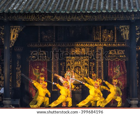 FOSHAN, CHINA - February 14, 2016: To celebrate the upcoming Chinese New Year, YueJuTuan in ancient temples for citizens performing classical dramas, attracted a large number of people watching. - stock photo