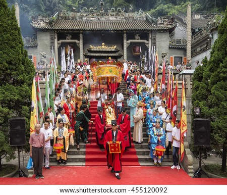 FOSHAN, CHINA - May 20, 2016: Birthday, Taoist god believers dressed in traditional costumes, with the traditional etiquette in beautifully temple worship offering activities. - stock photo