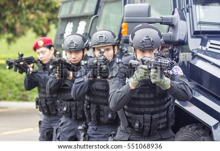 FOSHAN, CHINA - November 10, 2016:In order to improve the level of fighting against terrorism, armed police in outdoor training, police car, men's and women's police were involved in.