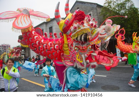 FOSHAN CITY - APRIL 12: To celebrate the birthday of the temple of God, Taoists held the China traditional culture parade, dance team performances in fish - Dragon April 12 , 2013 in Foshan, China