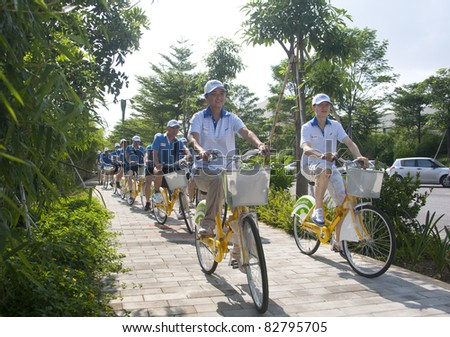 FOSHAN CITY, CHINA– AUGUST 13: Foshan Municipal Government organized bicycle parade promoting green traveling on August 13, 2011 in Foshan City, China