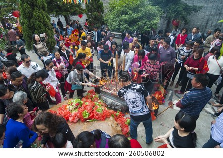 FOSHAN  Feb 27:Ninth day of the Chinese New Year, people worship offering a stone, the legend that sit on the stone can let want to pregnant women with children Feb 27, 2015 in Foshan, China - stock photo