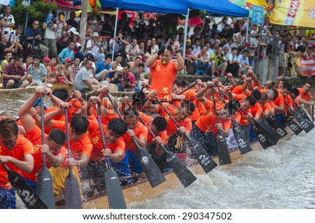 FOSHAN-June 23:The Dragon Boat Festival dragon boat in Fen rivers, there are 17 dragon boat teams took part in the game, attracted tens of thousands of people watched June 23, 2015 in Foshan, China - stock photo