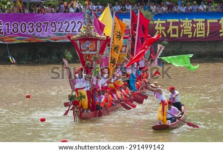 FOSHANâ??June 27: ZhangCha town dragon boat FenJiang rivers, there were 47 teams, before the game there is a dress up beautiful dragon boat on the river June 27, 2015 in Foshan, China - stock photo