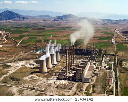 Fossil fuel power plant in operation, aerial view - stock photo