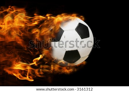 fotball in motion, making a flame - stock photo
