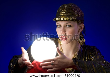 Fotune-teller with crystal ball - stock photo