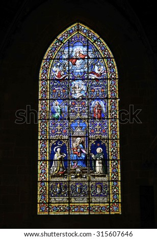 FOUGERES, FRANCE - JUNE 30, 2015: Beautiful stained glass of the Church Saint-Sulpice of Fougeres. The oldest parish church in Fougeres of Brittany, northwestern France.