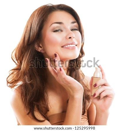 Foundation. Beauty Girl Putting on Makeup. Beautiful Woman Applying Make-up