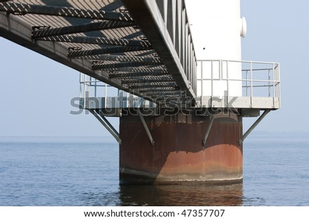 Foundation from a huge dutch windmill standing in the sea - stock photo