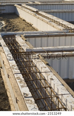 Foundation of a house just before the concrete will be poured between the walls. - stock photo