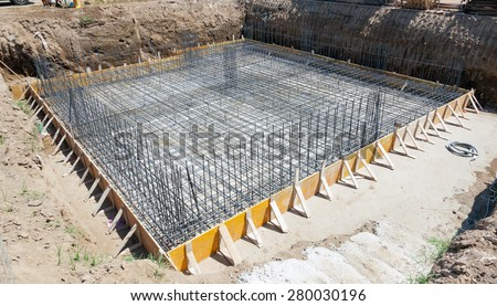 Foundation of a new house with reinforced concrete. - stock photo