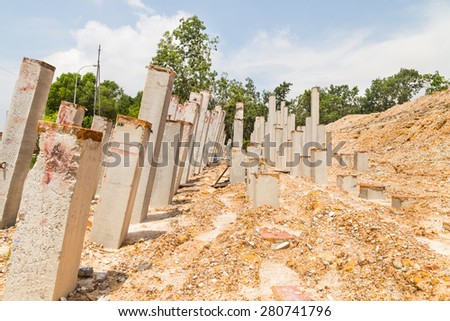 Foundation piling concrete columns at construction site - stock photo