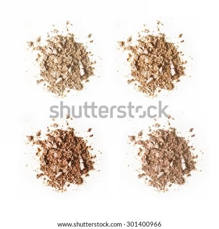 Foundation powder crushed samples set isolated on white background - stock photo