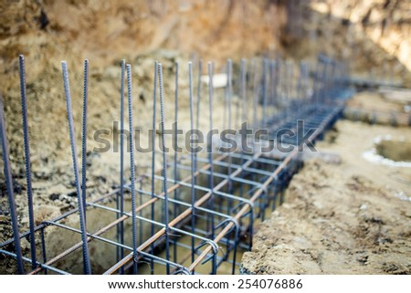 Foundation site of new building, details and reinforcements with steel bars and wire rod, preparing for cement pouring - stock photo