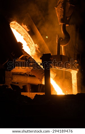 Founder Pouring Hot Liquid Metal - stock photo