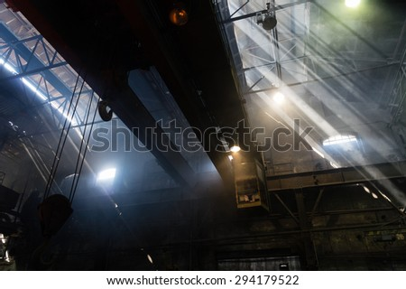 Foundry with crane in operation - stock photo