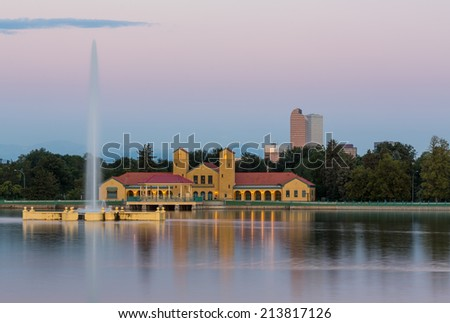 Fountain and Boathouse at Ferril Lake with the city skyline of Denver Colorado in background just before sunrise - stock photo