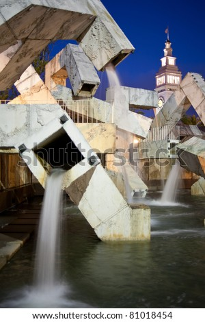 Fountain and Clock Tower, Ferry Building, San Francisco at dusk - stock photo